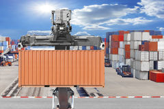Forklifts container being unloaded at the harbor. Forklift container being unloaded at the harbor Royalty Free Stock Images