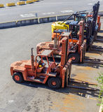 Forklifts. Lined up at shipping plant Stock Photography