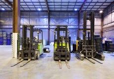 Forklifts no armazém Foto de Stock Royalty Free