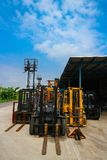 Forklift parking on the outdoor in the clear blue sky day stock photography