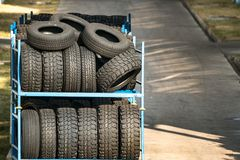 Forklifts and stack of car tires. 1 Royalty Free Stock Image