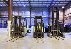 Forklifts in warehouse royalty free stock photo