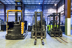 Forklifts in warehouse Royalty Free Stock Image