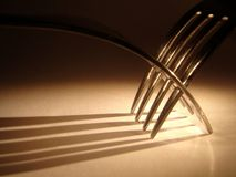 Forks. A closeup view of a two forks and their shadow forming a pattern Stock Image