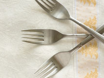 Forks. Three forks on the decorative table cloth Royalty Free Stock Photos