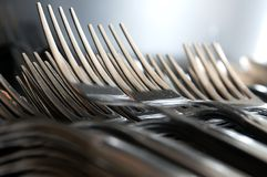 Forks arranged in series on the kitchen table Stock Photography