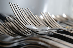 Forks arranged in series on the kitchen table. Royalty Free Stock Image