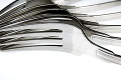 Forks arranged in series on the kitchen table. Stock Photo