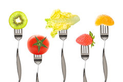 Forks with fruits  and vegetables Royalty Free Stock Image