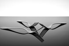 Forks on glossy table surface Stock Photos
