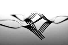 Forks on glossy table surface Royalty Free Stock Photography