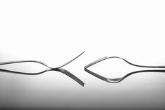 Forks on glossy table surface Royalty Free Stock Images