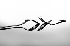 Forks on glossy table surface Stock Photo