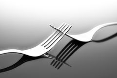 Forks on glossy table surface Royalty Free Stock Image