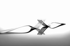 Forks on glossy table surface Stock Photography