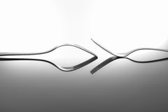 Forks on glossy table surface Stock Image