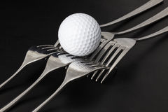 Forks and golf balls Stock Photo