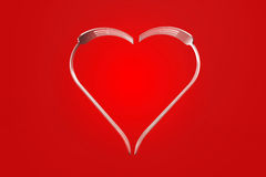Forks heart on red background Royalty Free Stock Image