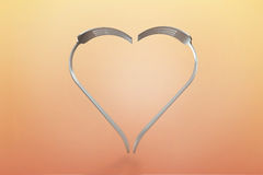 Forks heart on warm background Royalty Free Stock Image