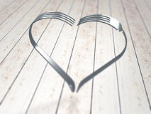 Forks heart on wood background Royalty Free Stock Photo