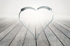 Forks heart on wood background Stock Images