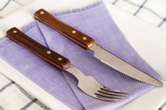 Forks and knives on a plate. royalty free stock photo
