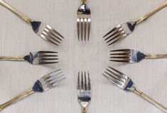 Forks on light background Royalty Free Stock Images