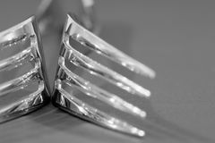 Two stainless steel forks close up. Macro photograph of two forks Stock Photography