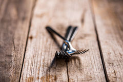 Forks on a old wooden table Royalty Free Stock Image