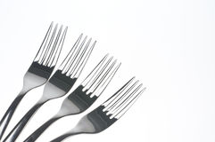 Forks over white. Forks isolated over white background Stock Photos