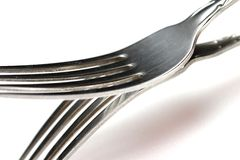 Forks. A set of silver forks on a white background Royalty Free Stock Photos