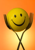 Forks & Smiley Royalty Free Stock Image