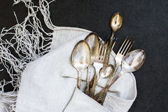 Forks and spoons on the tablecloth Royalty Free Stock Image