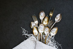 Forks and spoons on the tablecloth Stock Photo