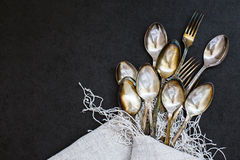 Forks and spoons on the tablecloth Royalty Free Stock Photo