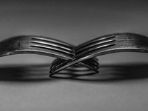 Forks together. A black and white photograph of forks stock photo