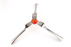 Forks and tomato Stock Photo