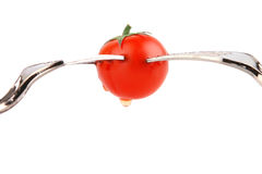 Forks and tomato Stock Images