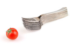 Forks and tomato isolated Stock Photo