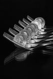 Forks and US dollar coins - Black and White Image Stock Photography