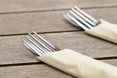Forks on wooden outdoors table Royalty Free Stock Images