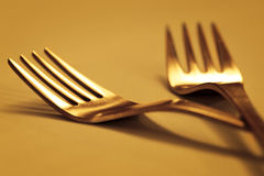 Forks02. Forks isolated on gold stock photography