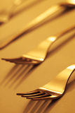 Forks03. Forks isolated on gold stock photo