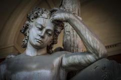 A worried Angel. Forli, Italy - February 15th 2018: Worried angel immersed in a deep thought Royalty Free Stock Images