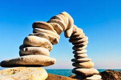Form of a arc. Stones laid out in the form of a arc on the seashore Stock Photo
