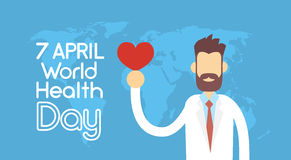 Form Arzt-Hold Red Heart über Weltkarte-Gesundheits-Tagesstaatsangehörigem April Holiday Stockfotos