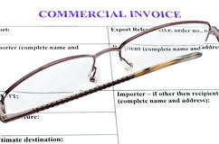 Form of commercial invoice. Spectacles lie on the form of commercial invoice Stock Images