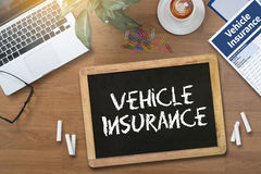 Form Document Vehicle Insurance Claim. Digital tablet pc, computer and cup of coffee on wooden table, with copy space Royalty Free Stock Photo