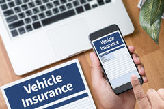 Form Document Vehicle Insurance Claim. Thoughtful male person looking to the digital phone screen,Silhouette top computer and hand Royalty Free Stock Images