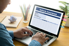 Form Document Vehicle Insurance Claim. Thoughtful male person looking to the digital tablet screen, laptop screen,Silhouette and filter sun Stock Images